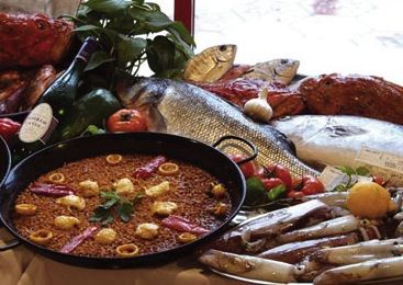 Paella-cooked rice with fish arroz con tropezones