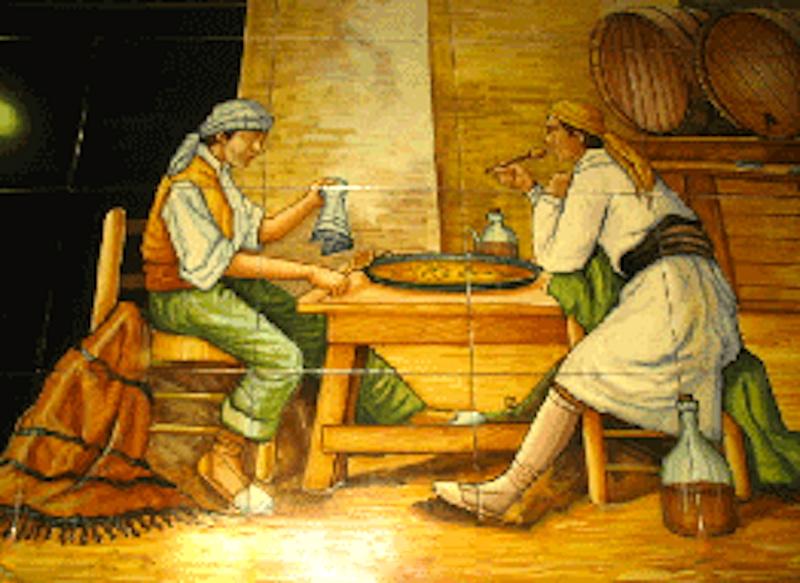 Azuleros de dos campesinos degustando una paella auténtica